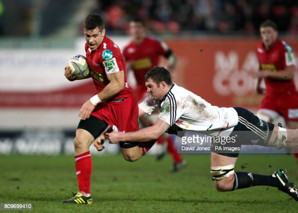 Llanelli Scarlets' Gareth Davies is tackled by Munster's Donnacha Ryan during the Heineken Cup match at Parc y Scarlets Llanelli