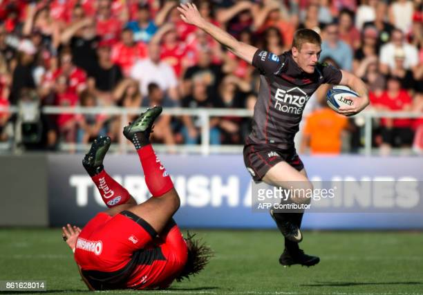 Llanelli's Welsh winger Johnny McNicholl avoids a tackle from RC Toulon's French centre Mathieu Bastareaud during the European Champions Cup rugby...
