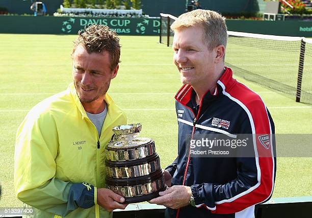 Llewton Hewitt captain of Australia and Jim Courier captain of the United States hold the cup during the official draw ahead of the Davis Cup Tie...