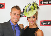 Lleyton Hewitt and Bec Hewitt at the Swisse Marquee on Melbourne Cup Day at Flemington Racecourse on November 4 2014 in Melbourne Australia