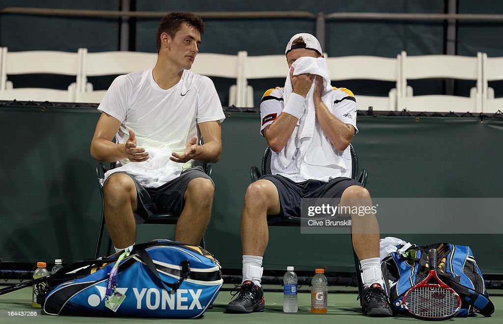 Lleyton Hewitt and Bernard Tomic of Australia talk in the change over against Ivan Dodig of Croatia and Marcelo Melo of Brazil during their first round doubles match at the Sony Open at Crandon Park Tennis Center on March 23, 2013 in Key Biscayne, Florida.