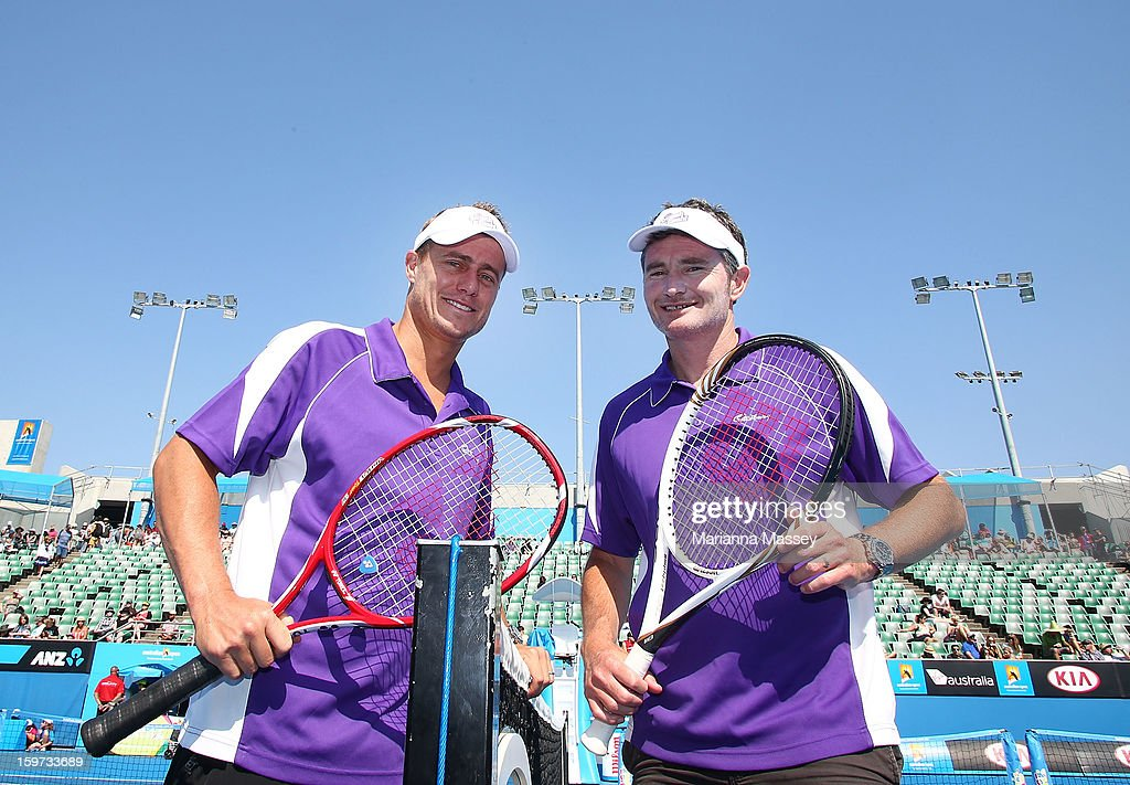 Lleyton Hewitt and Dave Hughes participate in the Cadbury Smash for Cash of the 2013 Australian Open at Melbourne Park on January 20, 2013 in Melbourne, Australia.