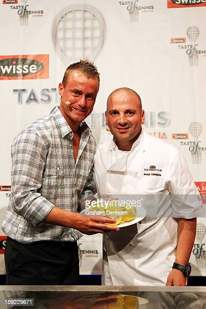 Lleyton Hewitt and George Calombaris pose during the Swisse Taste of Tennis at the Grand Hyatt on January 10 2013 in Melbourne Australia