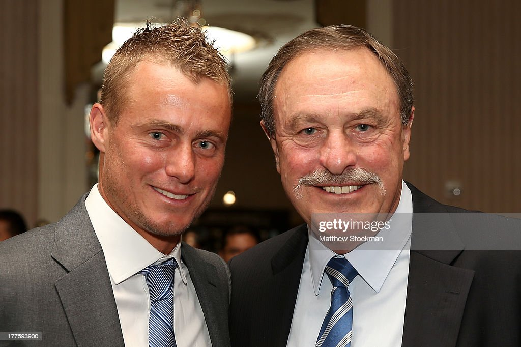 Lleyton Hewitt and John Newcombe of Australia pose for photographers during the ATP Heritage Celebration at The Waldorf=Astoria on August 23, 2013 in New York City.