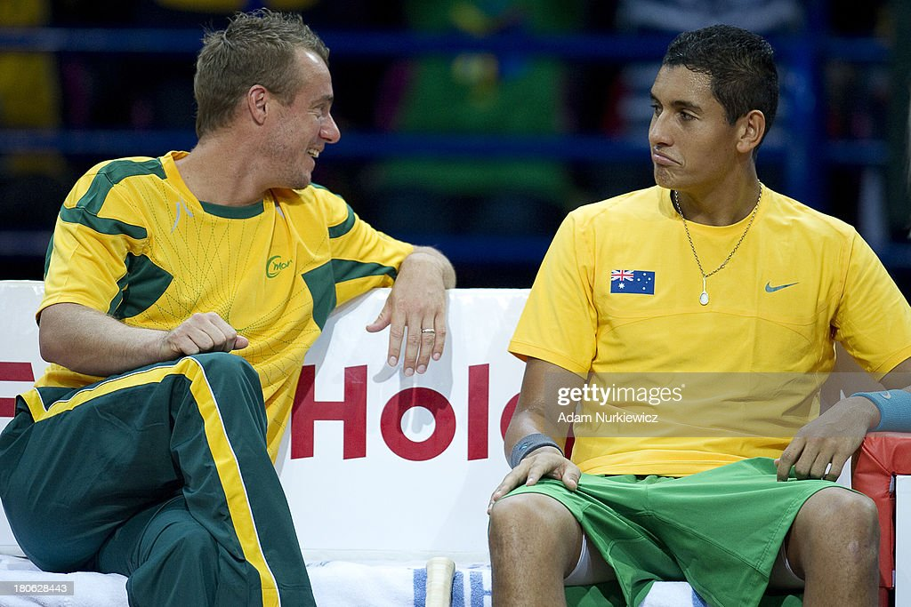 Lleyton Hewitt and (R) Nick Kyrgios both from Australia during the Davis Cup match between Poland and Australia at the Torwar Hall on September 15, 2013 in Warsaw, Poland.