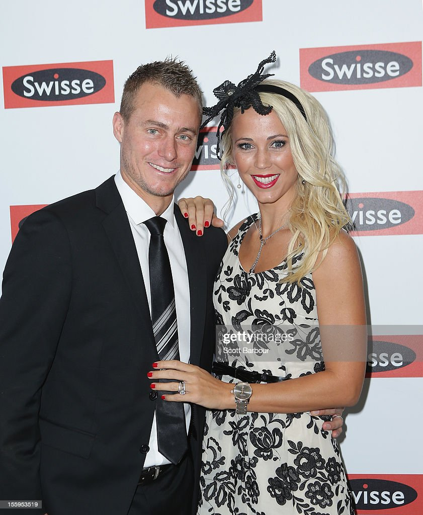 Lleyton Hewitt and Rebecca 'Bec' Hewitt attend the Swisse marquee on Stakes Day at Flemington Racecourse on November 10, 2012 in Melbourne, Australia.