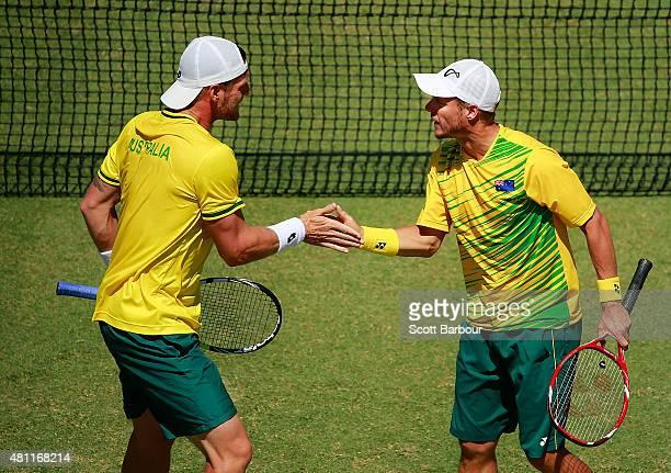 Lleyton Hewitt and Sam Groth of Australia celebrate winning a game as Sam Groth and Lleyton Hewitt of Australia play Andrey Golubev and Aleksandr...