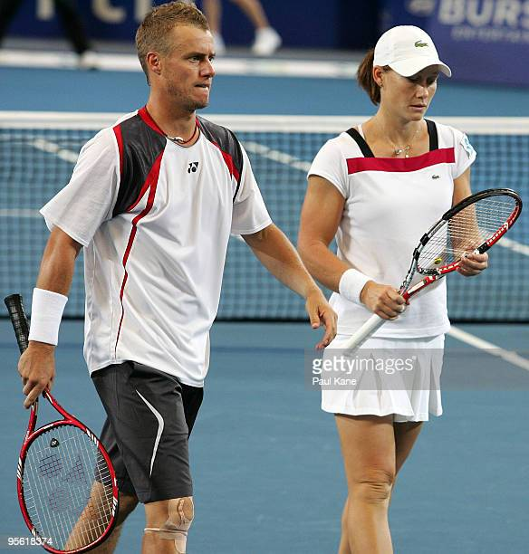 Lleyton Hewitt and Samantha Stosur of Australia look on in their mixed doubles match against Tommy Robredo and Maria Jose Martinez Sanchez of Spain...
