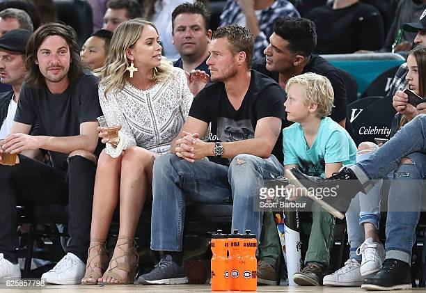 Lleyton Hewitt and Tully Smyth watch from the crowd during the round eight NBL match between Melbourne United and the Sydney Kings at Hisense Arena...