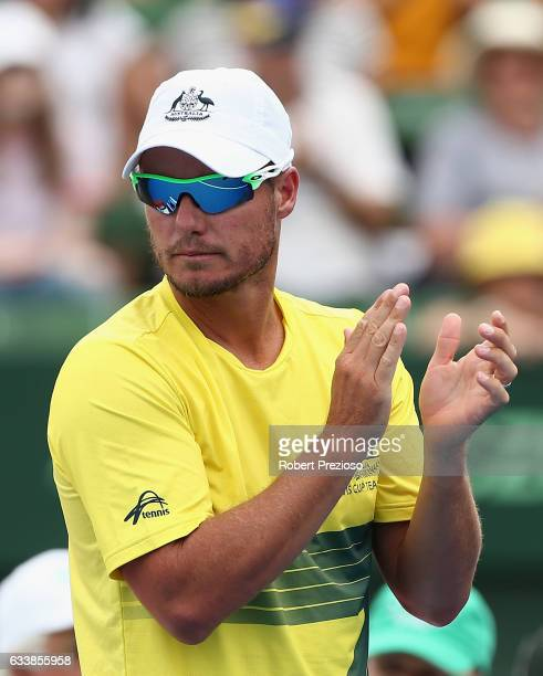 Lleyton Hewitt captain of Australia shows his support as Jordan Thompson of Australia competes in his singles match against Jan Satral of Czech...