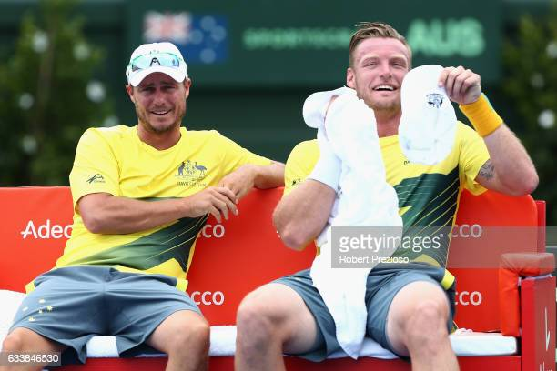 Lleyton Hewitt captain of Australia speaks with Sam Groth of Australia as he competes in his singles match against Jiri Vesely of Czech Republic...
