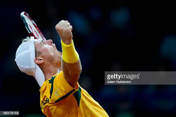 Lleyton Hewitt from Australia celebrates his victory in the first match during the Davis Cup match between Poland and Australia at the Torwar Hall on...