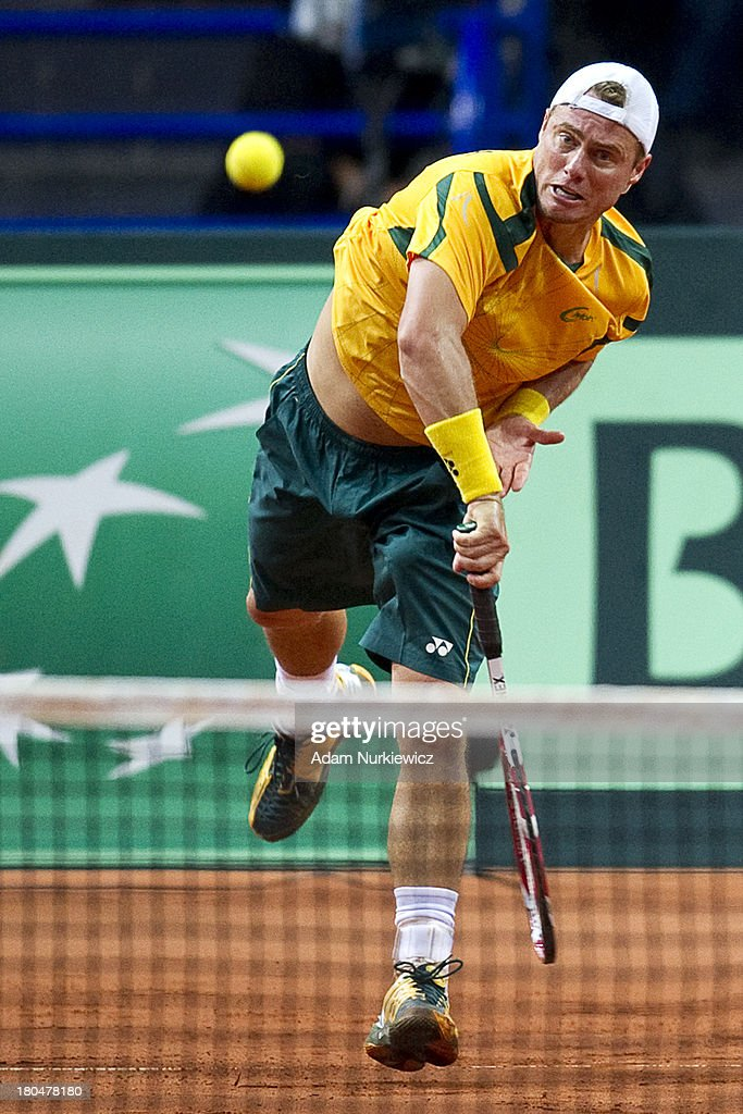 <a gi-track='captionPersonalityLinkClicked' href=/galleries/search?phrase=Lleyton+Hewitt&family=editorial&specificpeople=167178 ng-click='$event.stopPropagation()'>Lleyton Hewitt</a> from Australia in action during the Davis Cup match between Poland and Australia at the Torwar Hall, on September 13, 2013 in Warsaw, England.