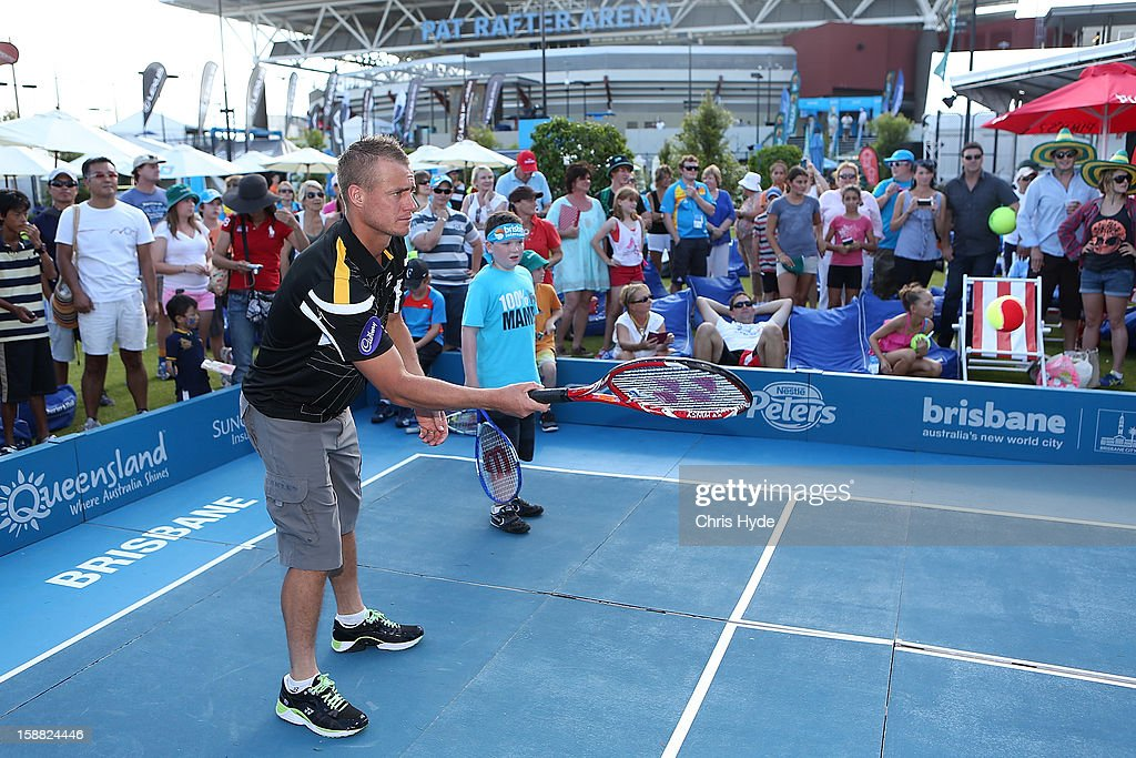 Lleyton Hewitt has a game of tennis with kids from tennis hot shots on day two of the Brisbane International at Pat Rafter Arena on December 31, 2012 in Brisbane, Australia.