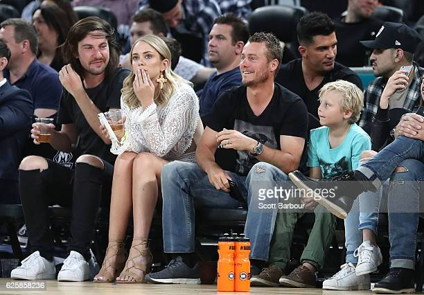 Lleyton Hewitt his son Cruz Hewitt and Tully Smyth watch from the crowd during the round eight NBL match between Melbourne United and the Sydney...