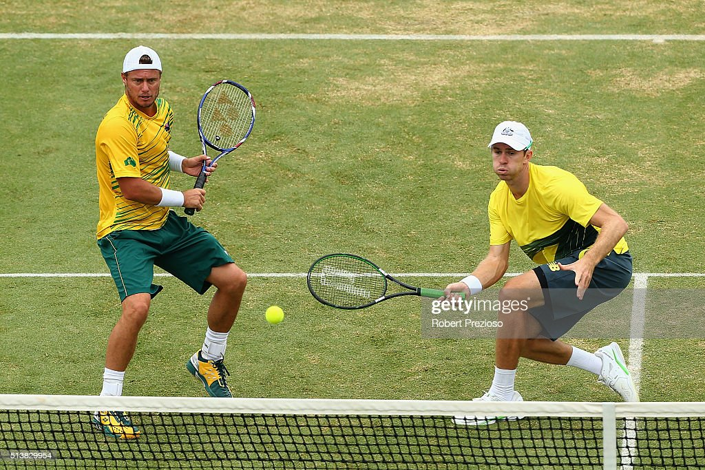 Lleyton Hewitt of Australia and John Peers of Australia in action in Men's doubles match against Mike Bryan and Bob Bryan of the United States during...