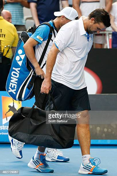 Lleyton Hewitt of Australia and Patrick Rafter of Australia leave the court after losing their first round doubles match against Eric Butorac of the...