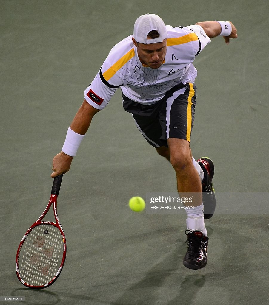 Lleyton Hewitt of Australia attempts to field a return against Stanislas Wawrinka of Switzerland during their WTA third round match at the BNP Paribas Open in Indian Wells, California on March 11, 2013. AFP PHOTO / Frederic J. BROWN