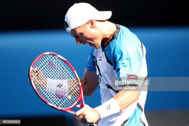 Lleyton Hewitt of Australia cel winning the third set in his first round match against Andreas Seppi of Italy during day two of the 2014 Australian...