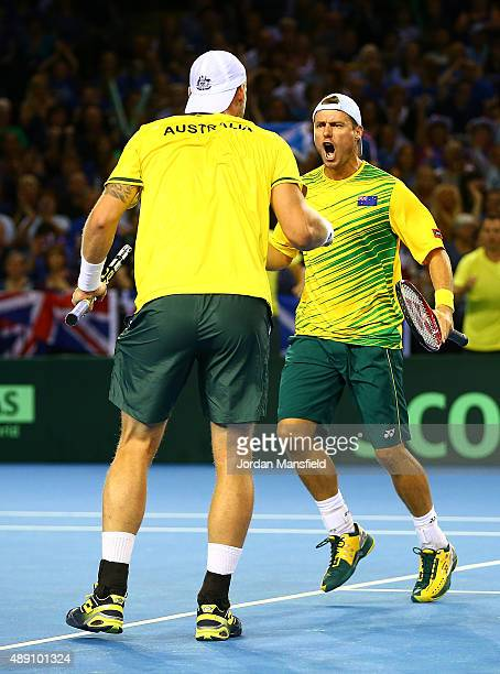 Lleyton Hewitt of Australia celebrates a point with Samuel Groth during Day Two of the Davis Cup Semi Final match between Great Britain and Australia...