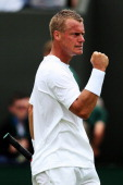 Lleyton Hewitt of Australia celebrates after winning his Gentlemen's Singles first round match against Michal Przysiezny of Poland on day two of the...