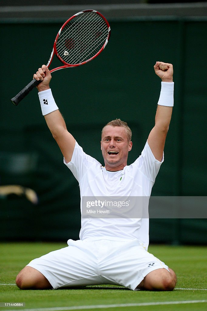 Lleyton Hewitt of Australia celebrates match point during his Gentlemen's Singles first round match against Stanislas Wawrinka of Switzerland on day one of the Wimbledon Lawn Tennis Championships at the All England Lawn Tennis and Croquet Club on June 24, 2013 in London, England.