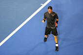 Lleyton Hewitt of Australia celebrates match point in his first round match against Ze Zhang of China during day two of the 2015 Australian Open at...