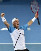 Lleyton Hewitt of Australia celebrates victory after his Mens finals match against Roger Federer of Switzerland during day eight of the 2014 Brisbane...