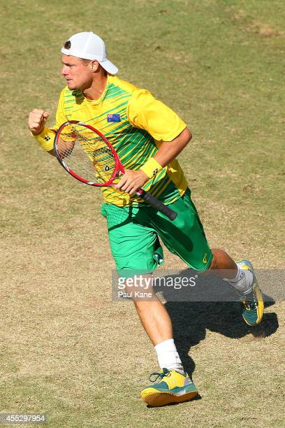 Lleyton Hewitt of Australia celebrates winning a game in his singles match against Farrukh Dustov of Uzbekistan during the Davis Cup World Group...