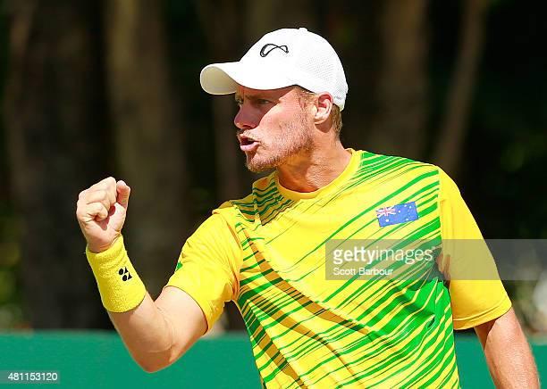 Lleyton Hewitt of Australia celebrates winning a point as as Sam Groth and Lleyton Hewitt of Australia play Andrey Golubev and Aleksandr Nedovyesov...