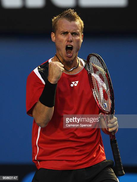 Lleyton Hewitt of Australia celebrates winning a point in his first round match against Ricardo Hocevar of Brazil during day two of the 2010...