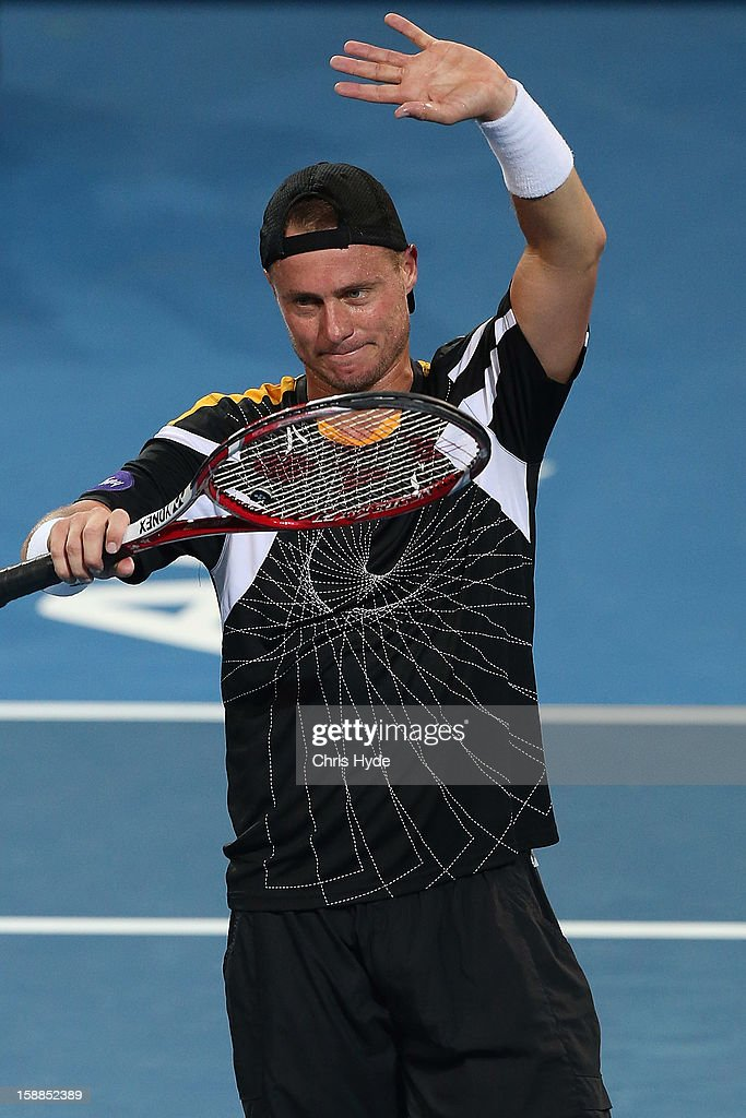 <a gi-track='captionPersonalityLinkClicked' href=/galleries/search?phrase=Lleyton+Hewitt&family=editorial&specificpeople=167178 ng-click='$event.stopPropagation()'>Lleyton Hewitt</a> of Australia celebrates winning his match against Igor Kunitsyn of Russia on day three of the Brisbane International at Pat Rafter Arena on January 1, 2013 in Brisbane, Australia.