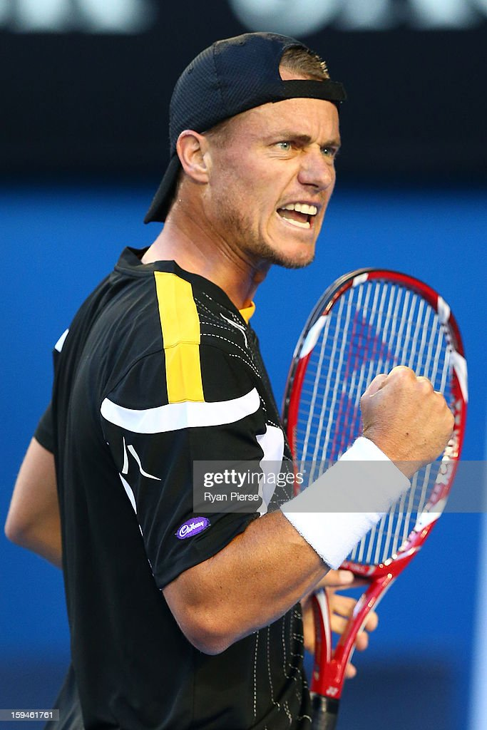 Lleyton Hewitt of Australia celebrates winning the first game in his first round match against Janko Tipsarevic of Serbia during day one of the 2013 Australian Open at Melbourne Park on January 14, 2013 in Melbourne, Australia.