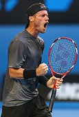 Lleyton Hewitt of Australia celebrates winning the first set in his first round match against Ze Zhang of China during day two of the 2015 Australian...