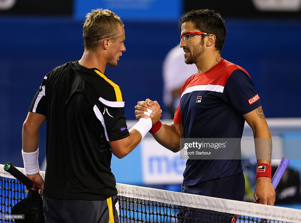Lleyton Hewitt of Australia congratulates Janko Tipsarevic of Serbia on winning their first round match against during day one of the 2013 Australian Open at Melbourne Park on January 14, 2013 in Melbourne, Australia.