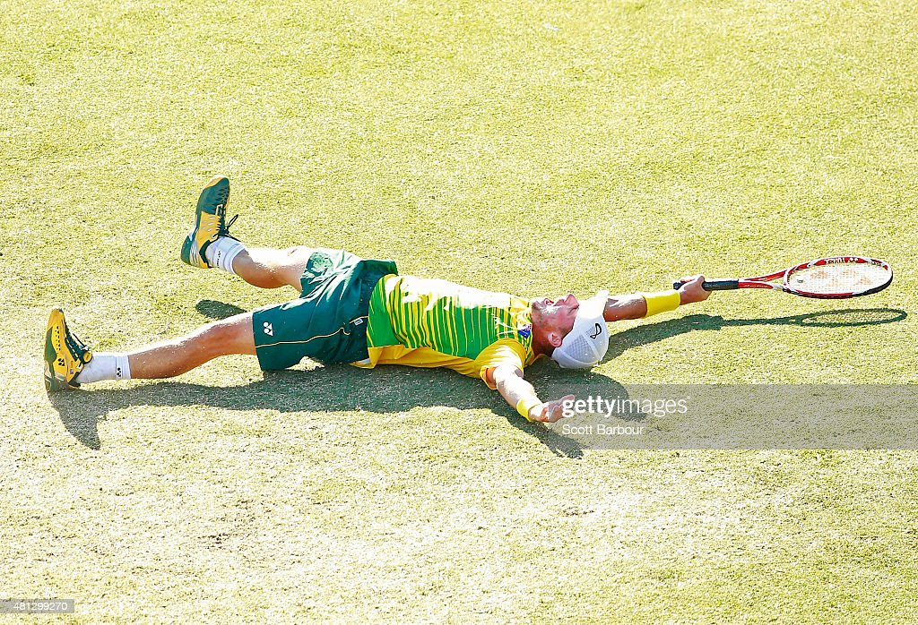 Lleyton Hewitt of Australia falls to the ground as he celebrates winning the reverse singles match between Lleyton Hewitt of Australia and Aleksandr Nedovyesov of Kazakhstan during day three of the Davis Cup World Group quarterfinal tie between Australia and Kazakhstan at Marrara Sporting Complex on July 19, 2015 in Darwin, Australia.
