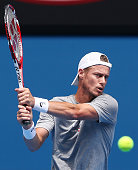 Lleyton Hewitt of Australia hits a backhand during a practice session ahead of the 2015 Australian Open at Melbourne Park on January 18 2015 in...