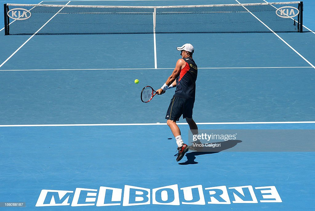 <a gi-track='captionPersonalityLinkClicked' href=/galleries/search?phrase=Lleyton+Hewitt&family=editorial&specificpeople=167178 ng-click='$event.stopPropagation()'>Lleyton Hewitt</a> of Australia hits a backhand during practice ahead of the 2013 Australian Open at Melbourne Park on January 11, 2013 in Melbourne, Australia.