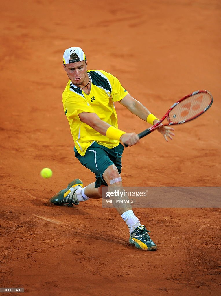 Lleyton Hewitt of Australia hits a backhand return in his match against Tatsuma Ito of Japan during their Davis Cup tennis tie played in Brisbane on May 7, 2010. RESTRICTED TO EDITORIAL USE � NO ADVERTISING USE - NO PROMOTIONAL USE � NO MERCHANDISING USE AFP PHOTO/William WEST