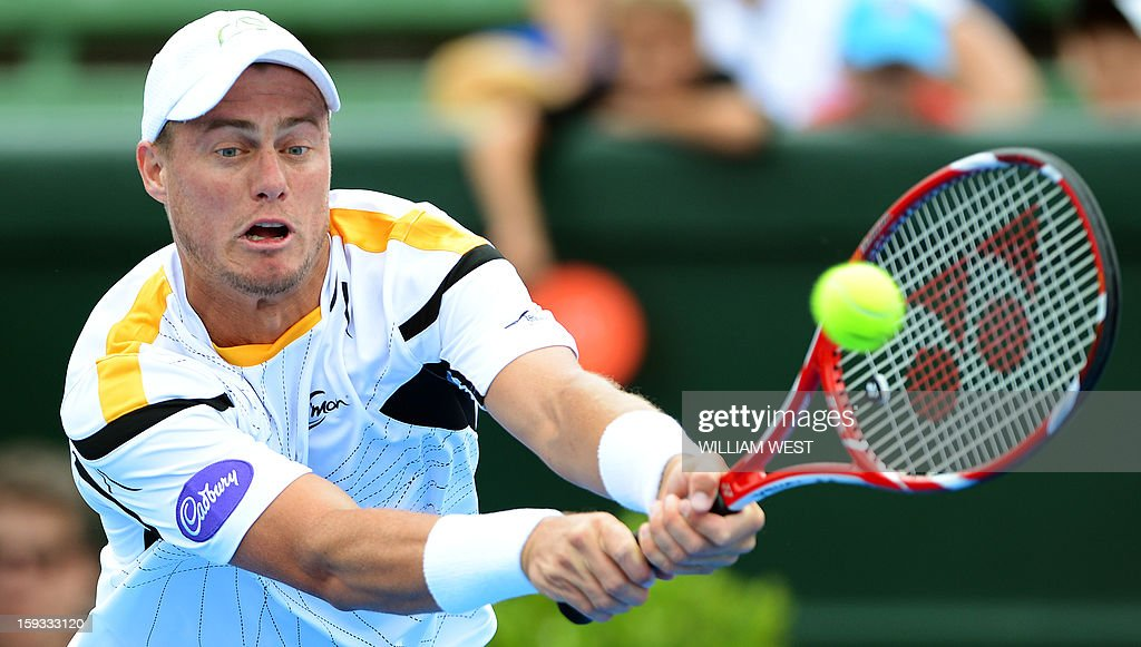 Lleyton Hewitt of Australia hits a backhand return on the way to defeating Juan Martin Del Potro of Argentina in the final of the Kooyong Classic in Melbourne on January 12, 2013. AFP PHOTO/William WEST USE