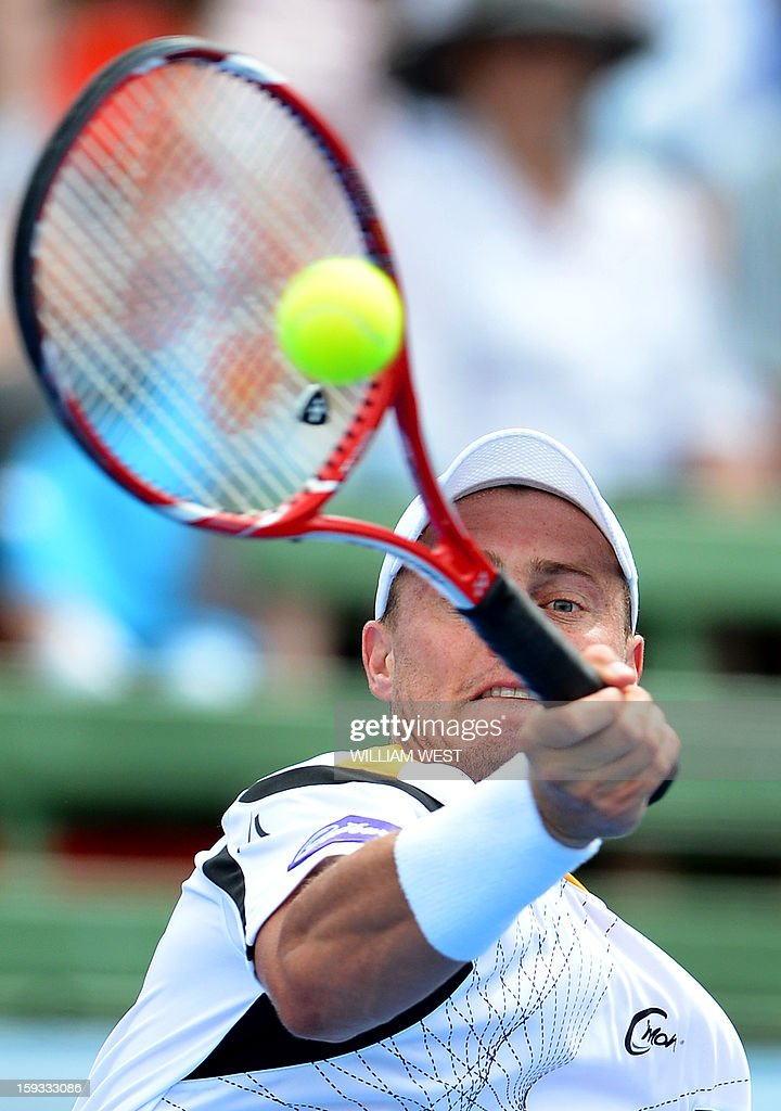 Lleyton Hewitt of Australia hits a forehand return on the way to defeating Juan Martin Del Potro of Argentina in the final of the Kooyong Classic in Melbourne on January 12, 2013. AFP PHOTO/William WEST USE