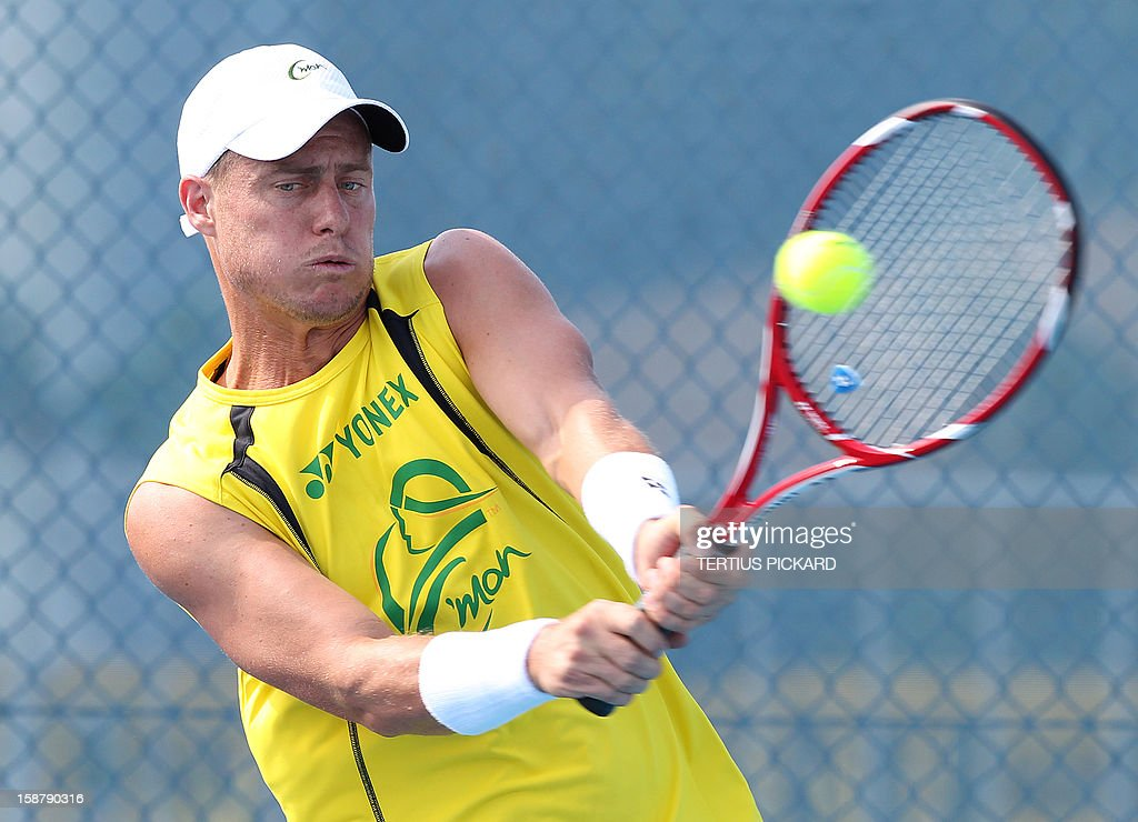 Lleyton Hewitt of Australia hits a return during a training session in Brisbane on December 29, 2012, ahead of the upcoming Brisbane International tennis tournament. Top international men's and women's players are using the Brisbane International as a build-up to the Australian Open, which runs from January 14 to 27. AFP PHOTO/Tertius PICKARD USE