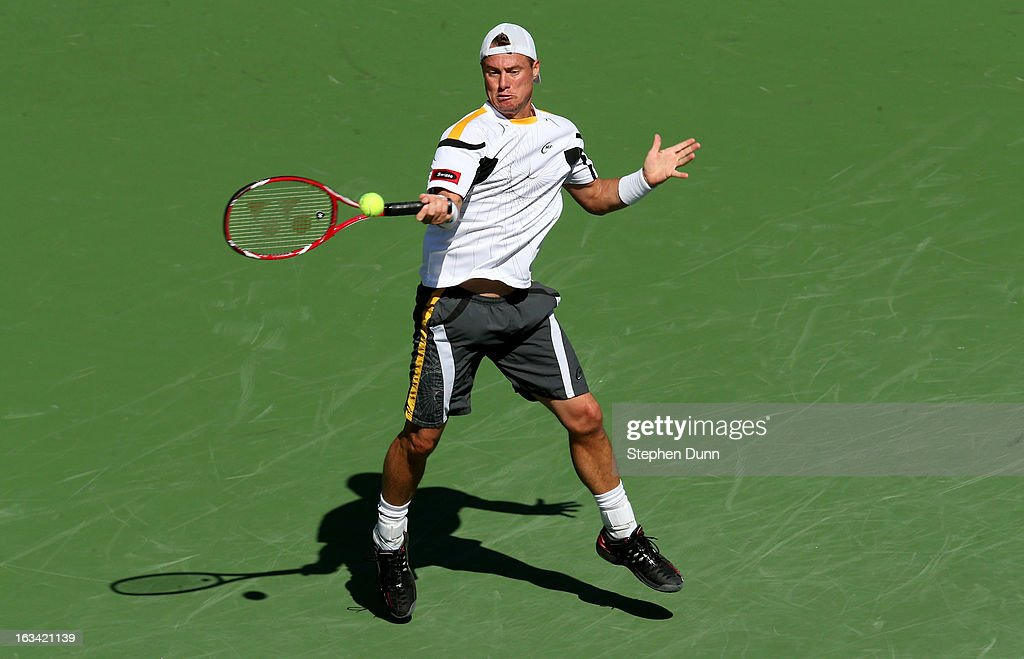 Lleyton Hewitt of Australia hits a return to John Isner during day 4 of the BNP Paribas Open at Indian Wells Tennis Garden on March 9, 2013 in Indian Wells, California. Sto0sur won 6-3, 6-4.