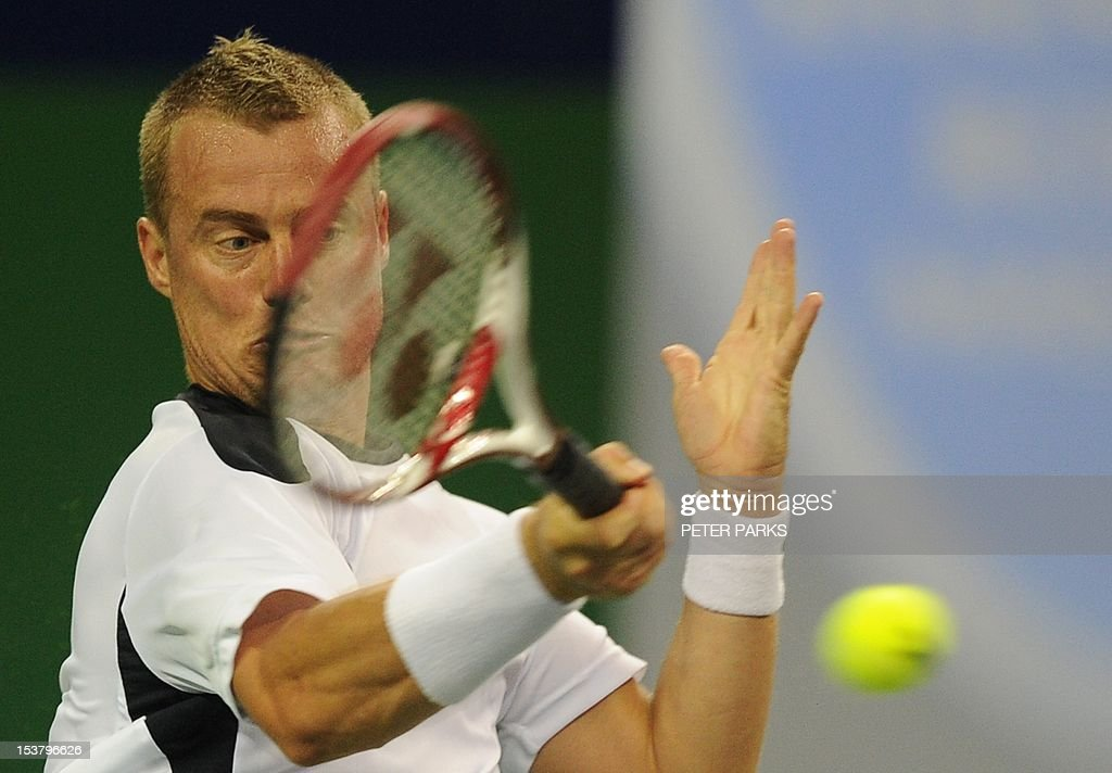 Lleyton Hewitt of Australia hits a return to Radek Stepanek of the Czech Republic in their first round match of the Shanghai Masters tennis tournament in Shanghai, on October 9, 2012. AFP PHOTO / Peter PARKS