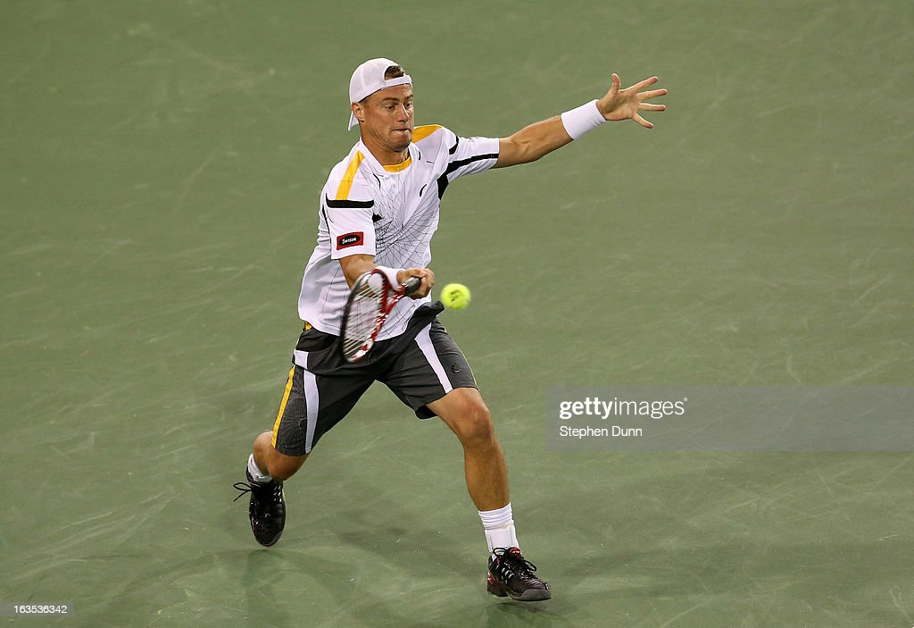 <a gi-track='captionPersonalityLinkClicked' href=/galleries/search?phrase=Lleyton+Hewitt&family=editorial&specificpeople=167178 ng-click='$event.stopPropagation()'>Lleyton Hewitt</a> of Australia hits a return to Stanislas Wawrinka of Switzerland during day 6 of the BNP Paribas Open at Indian Wells Tennis Garden on March 11, 2013 in Indian Wells, California. (Photo by Stephen Dunn/Getty Images).