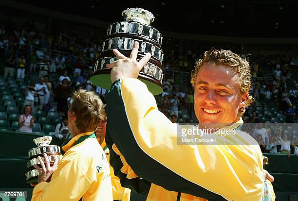 Lleyton Hewitt of Australia holds his replica of the cup after Australia defeated Spain in the Davis Cup Final at Melbourne Park on November 30 2003...