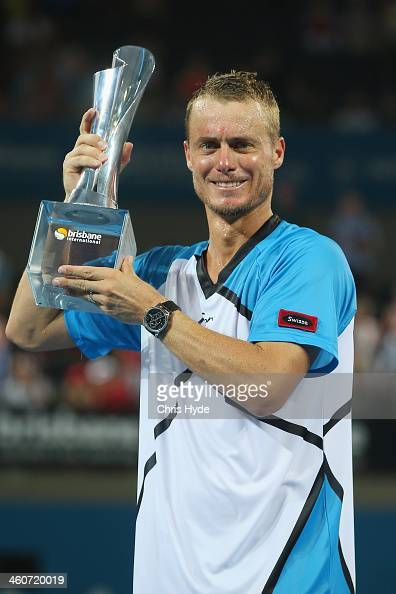 Lleyton Hewitt of Australia holds the winners trophy after winning the mens final match against Roger Federer of Switzerland during day eight of the...