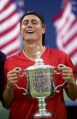 Lleyton Hewitt of Australia holds up his championship trophy after defeating Pete Sampras of the United States 76 61 61 in mens' final match at the...