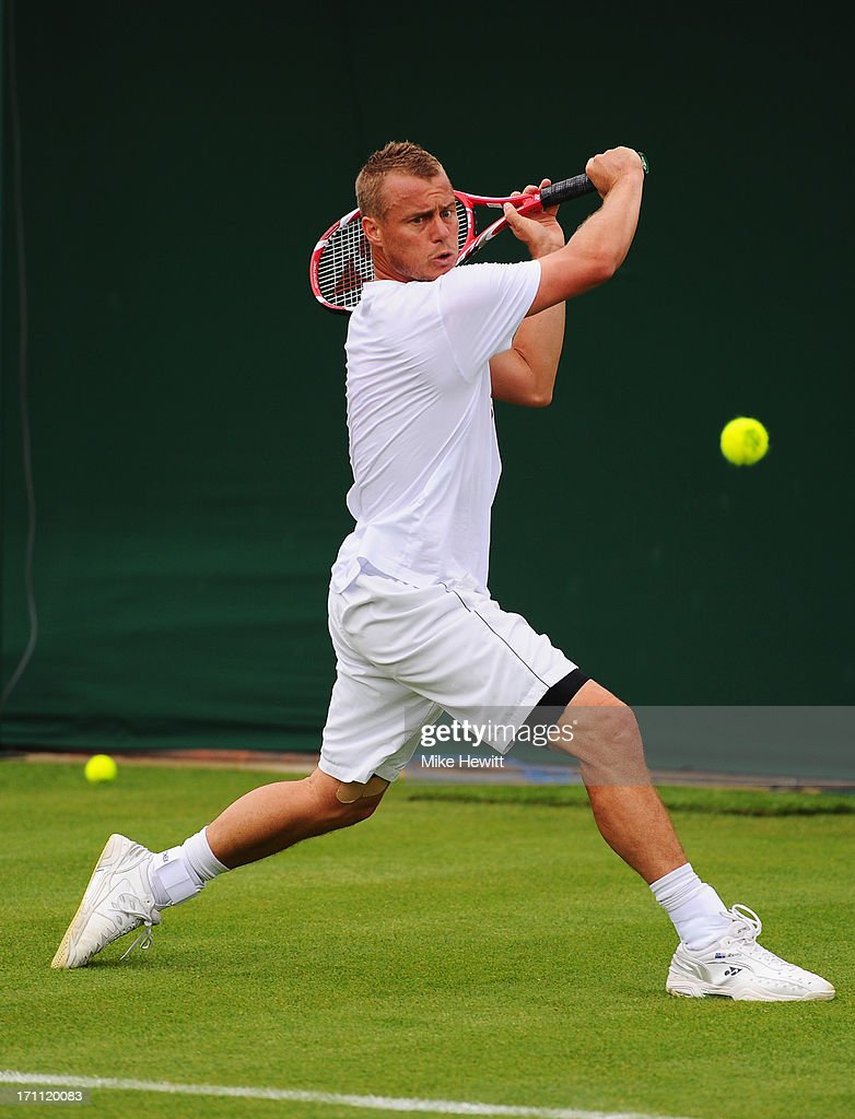 Lleyton Hewitt of Australia in action during a practice session ahead of the Wimbledon Championships at Wimbledon on June 22, 2013 in London, England.