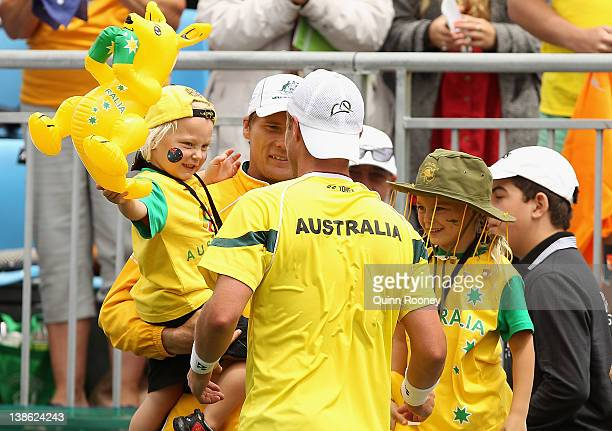Lleyton Hewitt of Australia is congratulated by his kids Cruz and Mia after winning his singles match against Zhang Ze of China during day one of the...